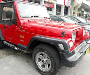 Slide_jeep-wrangler-1990-10674572