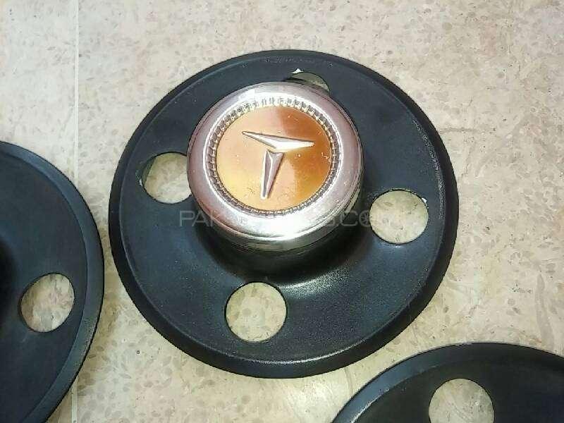 Toyota Corolla oldschool wheel caps Image-1