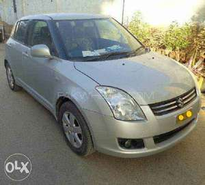 Slide_suzuki-swift-1-3l-dlx-2010-12362625