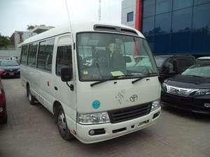 Slide_toyota-coaster-26-seater-f-l-2014-12515028