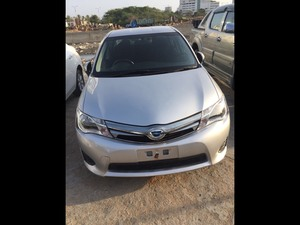 Toyota Corolla Axio Hybrid 1.5 2013 for Sale in Karachi