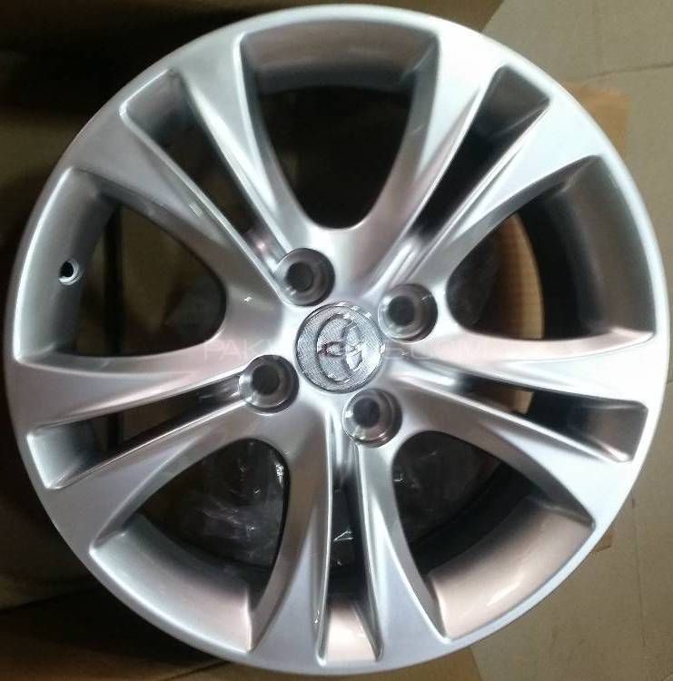 ALLOY WHEEL 15 INCH 4 NUTS Image-1