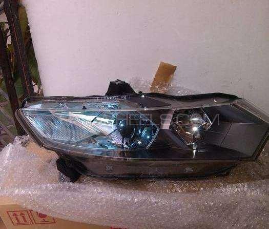 Honda insight ze2 head lamp Image-1