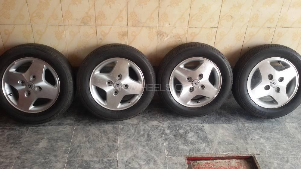 155/65r13  tyres with  japani alloy rims lash condition 8 /10 Mehran Image-1