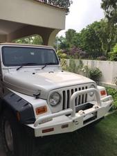 Slide_jeep-wrangler-sahara-2002-17771091