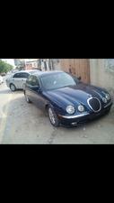 Slide_jaguar-s-type-2001-18375938