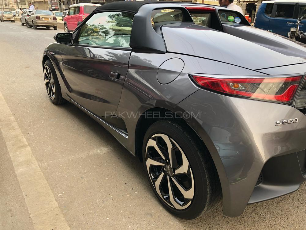 Honda S-660 Sports, α (Alpha) Package,  Automatic CVT 660 Cc,  ( Turbo charged ), Admiral Gray Metallic,  Model 2015, Fresh Import/Cleared 2018, Original Auction Sheet(Verifiable), Original 18,000 K.M ( Verifiable ), Push Start ( Honda Smart Key System ), Power Rear Window, Sports Mode ( Push Sports Switch ), Digital Soeedometer/Tachometer/ Fuel Meter, Central Locking,  Honda Exclusive smallest steering wheel, Special Momentary Cognitive Meter, Honda Original sports Black leather seats, Removable Roof, Original Honda Lightweight Alloy Rim, Sports Design Door Mirror, Air-Condition, Safety Air-bags, 100 % Genuine/ Guarantee.