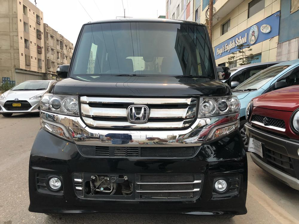 "®GARIWALA® Honda N-Box CUSTOM , Pearl Black, Sofa seat,  GL  Package,Un-Registered, Model 2015, Cleared 2018,  Original 24,000 K.M, Push Start, Retractable Mirrors,  Traction Control, Climate Control, Fog lights, HID lights  14"" Alloy Wheels, DvD/CD/ Back/reverse camera player. 100% Genuine/ Guarantee"