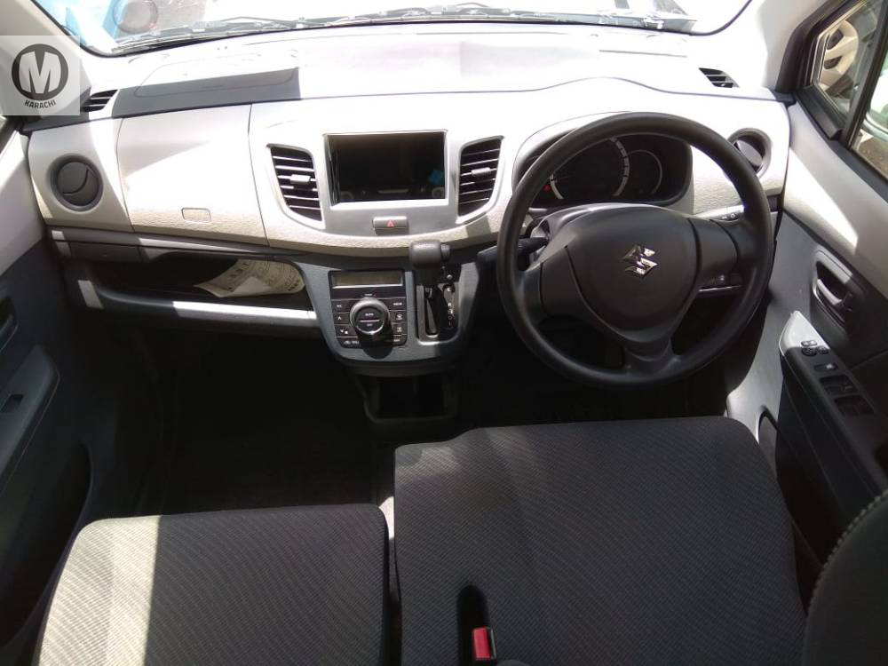 Suzuki Wagon-R FX  2015 Model  660 cc  27,000 km  Black Colour  4 Grade   Complete Auction Sheet Available,  Just Like A Brand New Car.   ===================================   Merchants Automobile Karachi Branch,  We Offer Cars With 100% Original Auction Report Based Cars With Money Back Guarantee.  Recommended Tips To Buy Japanese Vehicle:   1. Always Check Auction Report.  2. Verify Auction Report From Someone Else.  3. Ask For Japan Yard Pics If Possible.   MAY ALLAH CURSE LIARS..
