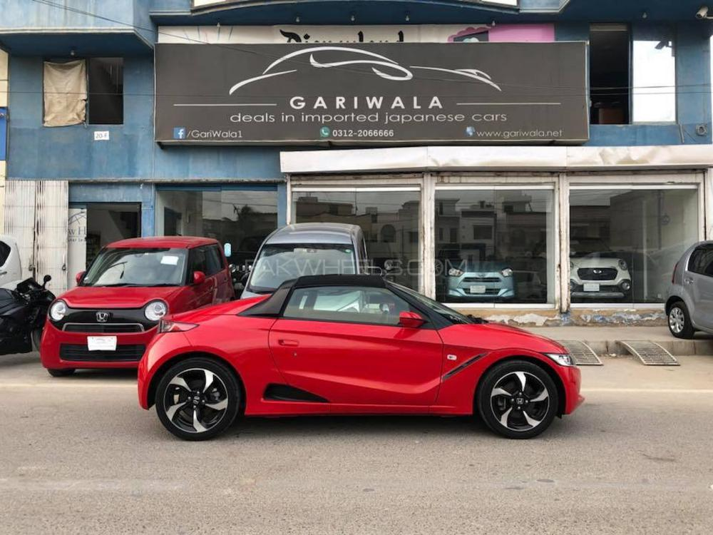 Honda S-660 Sports, α (Alpha) Package,  Automatic CVT 660 Cc,  ( Turbo charged ), Frame Red,  Model 2015, Import 2018, Registered KARACHI 2018 Single Owner, Original 4-A Grade Auction Sheet (Verifiable), Original 24,000 K.M When Import (Verifiable), Original 40,000 K.M  Current Mileage  Push Start ( Honda Smart Key System ), Power Rear Window,  Special Registration Number,  Sports Mode ( Push Sports Switch ), Digital Speedometer Tachometer Fuel Meter, Central Locking,  Honda Exclusive smallest steering wheel, Special Momentary Cognitive Meter, Honda Original sports Black leather seats, Removable Roof Soft Top,  Original Honda Lightweight Alloy Rim, Sports Design Door Mirror, Air-Condition, Safety Air-bags, 100 percent Genuine Guarantee.