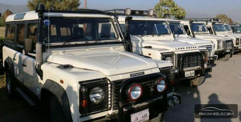 Land Rover Defender - 2005  Black and White Bus Image-1